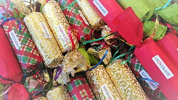 Volunteers fill and wrap Christmas Crackers