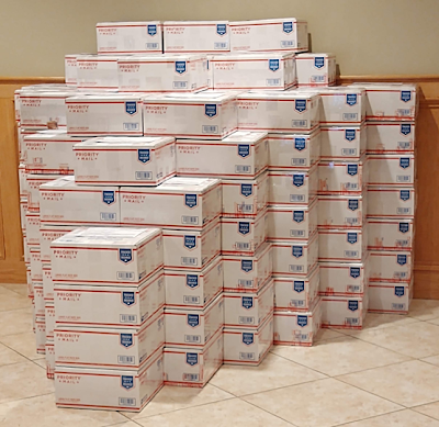 151 Care Packages stacked in a pyramid