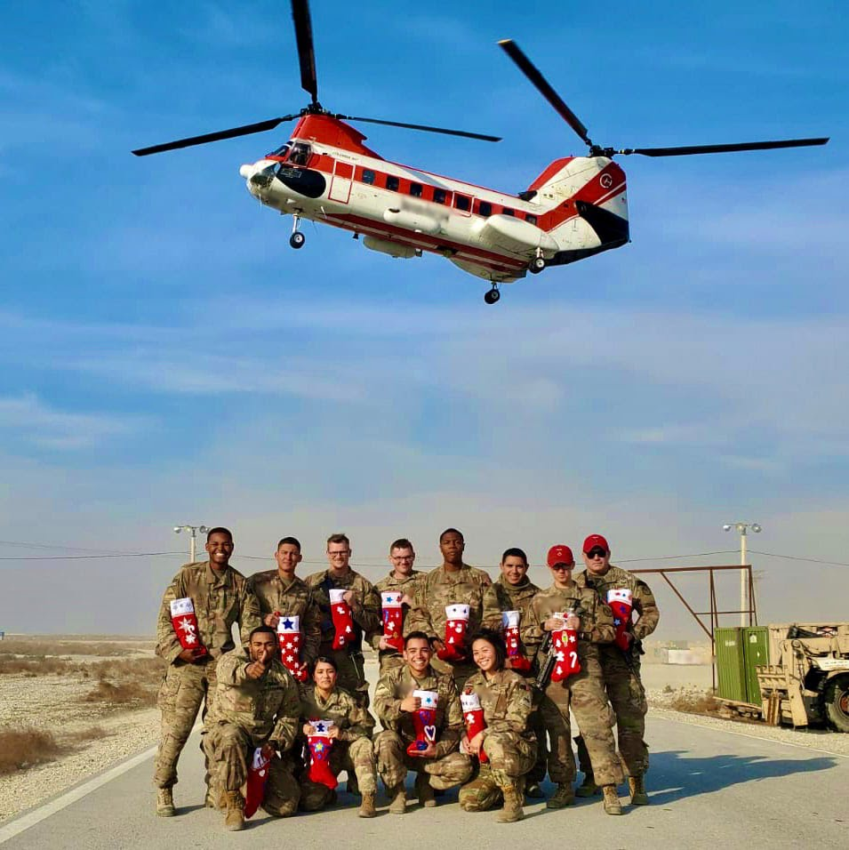 Soldiers in Santa hats say thanks for the care packages